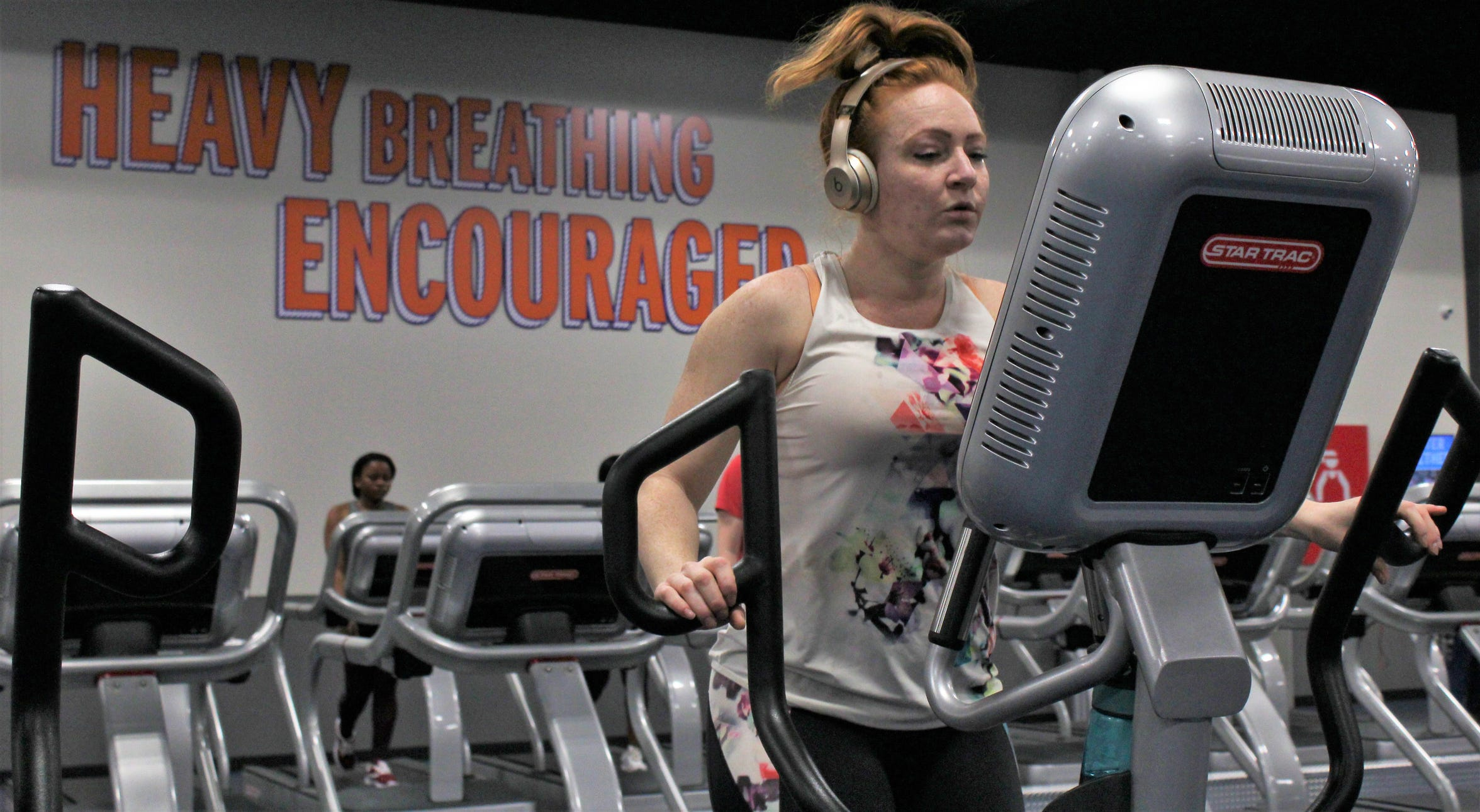 Rebecca Lee works out Friday afternoon on an elliptical-type machine at the new Crunch Fitness. She previously trained at a Crunch Fitness in another city and welcomed the chance to return.