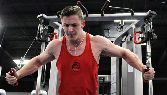 Nolan Ritchie works his chest Friday at Crunch Fitness before going to work at Complete Nutrition.