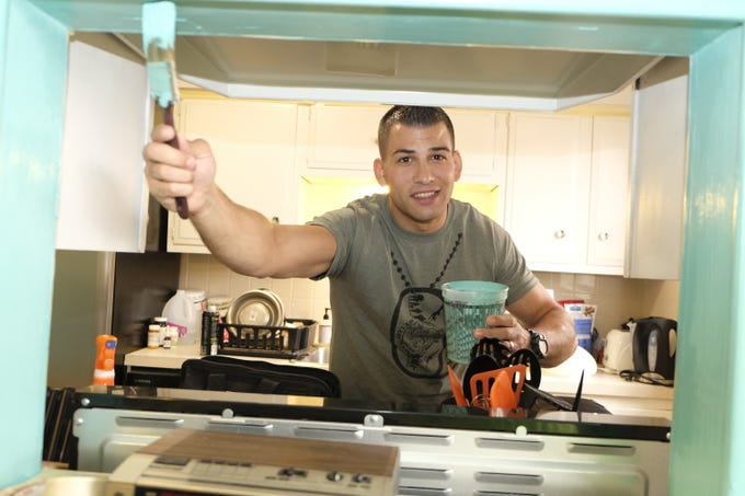 Airman 1st Class Dustin Osborne participates in his first Dyess We Care Team project in February.