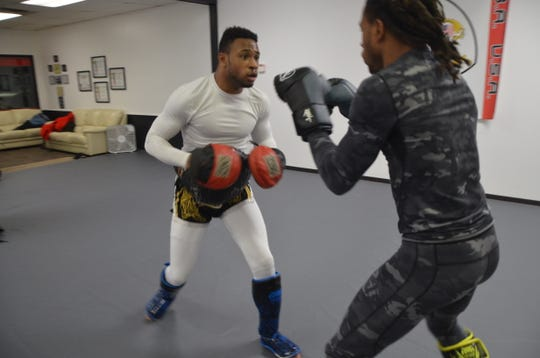 Idris (left) and Abasi Perry train together  at Mushin Academy of Martial Arts on Thursday, Jan. 3, 2019.