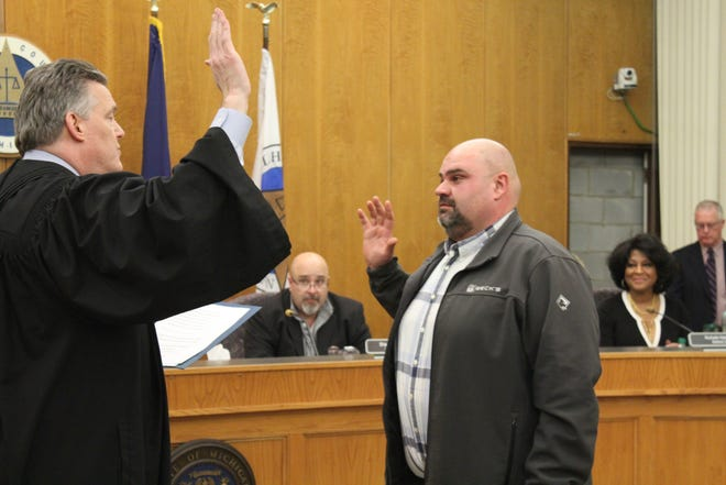 Tommy Miller was sworn in by Chief Judge Michael Jaconette as county commissioner for the 6th District at Thursday's county board meeting. Miller resigned from his county road worker job at the meeting so he could take office as a county commissioner.
