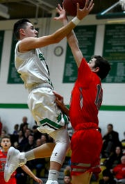 Seton's Tyler Rumpel (3) looks to score as Seton Catholic Central varsity basketball hosts Chenango Valley in Binghamton on Thursday, January 3, 2018.