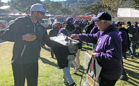 "Noah Garguile hands out some ""Browning brownies"" before the Rose Bowl."