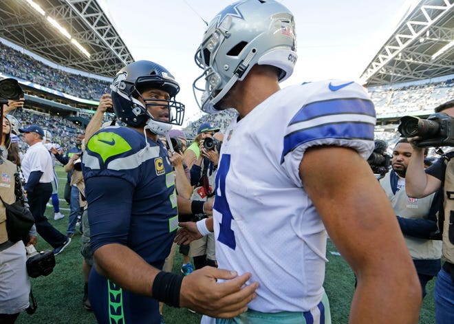 Seahawks quarterback Russell Wilson greets Cowboys quarterback Dak Prescott after a September game in Seattle.