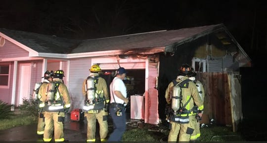 Brevard County Fire Rescue personnel respond to a house fire in Port St. John.