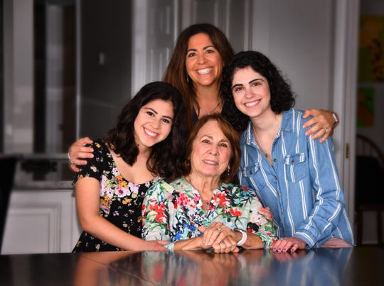 "Alex Dixon (in blue) with her sister Jessica, her mom Juli and her grandmother Joy Inventasch.  Alex had a near fatal stroke when she was 12 and had to relearn almost everything. She is now a junior at UCF. Her Mom, Dr. Juli Dixon and her sister Jessica wrote a book, ""A Stroke of Luck"" on her journey back."