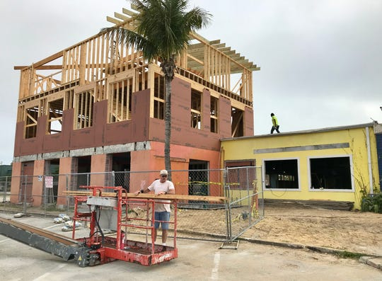 Crews are framing a third story atop the old City Tropics Bistro in Indialantic.