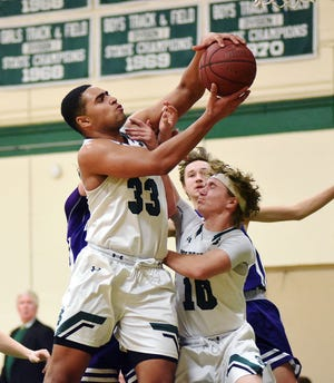St. Johnsbury's Asom Hayman-Jones snares the offensive rebound in front of teammate Trey Alercio during the Hilltoppers' 59-39 win over visiting Brattleboro at on Thursday, Jan. 3, 2019.