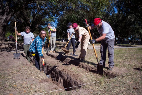 Texas State University master's students and staff dig near an area, Friday, January 4, 2019, in which 33 unidentified bodies were exhumed in 2014 at Sacred Heart Burial Park in Falfurrias. Without markers or anything to identify graves where migrants may have been buried, the volunteers are relying on the memories of people who remember where people were buried, Kate Spradley, Texas State University professor of anthropology. The Forensic Border Coalition is continuing its mission of identifying migrants and volunteers are at the burial park searching for unidentified remains.