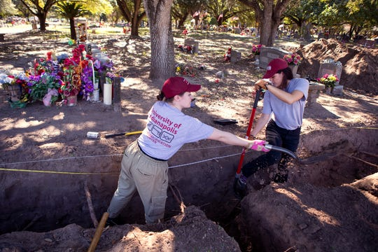 University of Indianapolis graduate students Arden Mower (left) and Samantha Beck dig on a corner near the road in search of unidentified human remains at Sacred Heart Burial Park in Falfurrias on Friday, January 4, 2019. The groundskeeper told volunteers exhuming bodies that migrants would often be buried in the corner of the cemetery, so volunteers have resumed their work with focusing on those areas, said Krista Latham, Director of the Human Identification Center and associate professor of biology and anthropology.