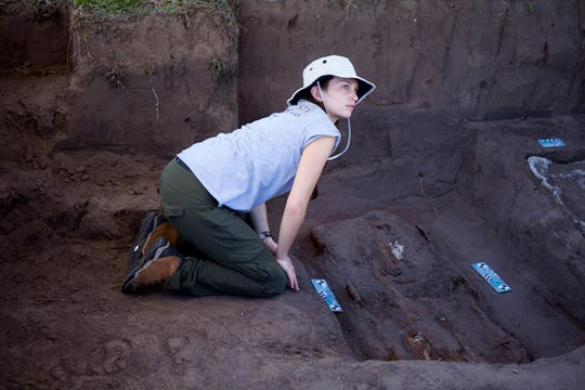 Texas State University master's student Molly Kaplan places a marker in a grave as imaging is taken during exhumations of unidentified remains at Sacred Heart Burial Park in Falfurrias on Friday, January 4, 2019. The Forensic Border Coalition is working to identify migrants.