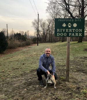 Riverton resident Carlos Rogers has been the dog-loving  force behind a planned canine park along the NJ Transit Riverline ( to left behind hedgerow) in Riverton Memorial Park. He wants his French pug Ruby and other large and small dogs to be able to have a local place to socialize and romp.