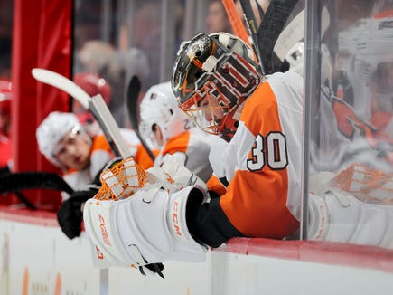 Michal Neuvirth allowed three goals on seven second-period shots and the Flyers lost to the Carolina Hurricanes 5-3 Thursday.