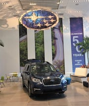 An eight-passenger Ascent is displayed at Subaru of America headquarters in Camden.