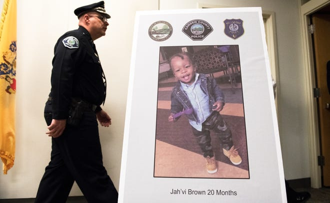 Camden County Police Department's Assistant Chief Joe Wysocki walks past a photo of Jah'vi Brown, following a press conference held in Camden on Friday, January 4, 2019, to announce that the child's remains found in a Camden alley in October were identified as Brown's.