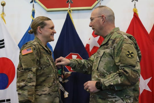 Lt. Col. Colleen (Kell) Burgemaster was promoted on Dec. 12 at an Army installation in Pyeongtaek, South Korea by the Eighth Army Deputy Commanding General, Maj. Gen. Daniel Christian.