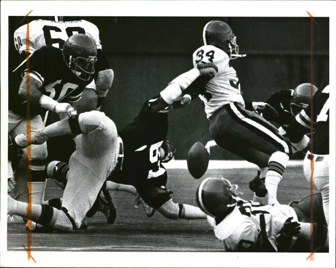 Dec 18, 1978 - Ball Slips from Browns' Greg Pruitt as Bengals' Gary Burley grabs his arm.