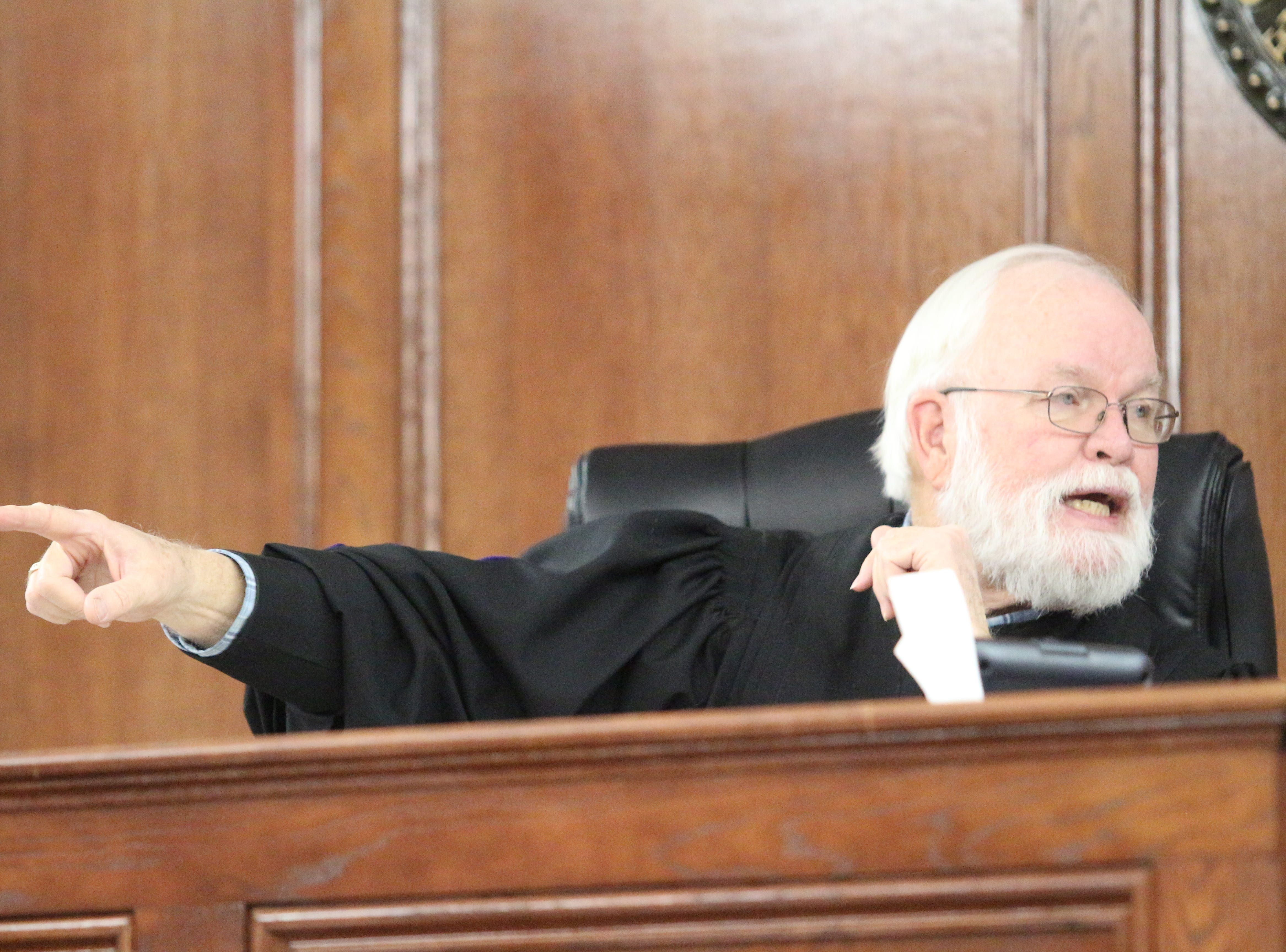 General Sessions Judge Wayne Shelton getting upset over the disregard of life as he listens to details of two groups of men who may have been shooting at one another from cars before fatal shooting and wreck. He asks the detective if the other driver had been shot if he would be sitting where Vincent Merriweather was, in the defendant's chair.