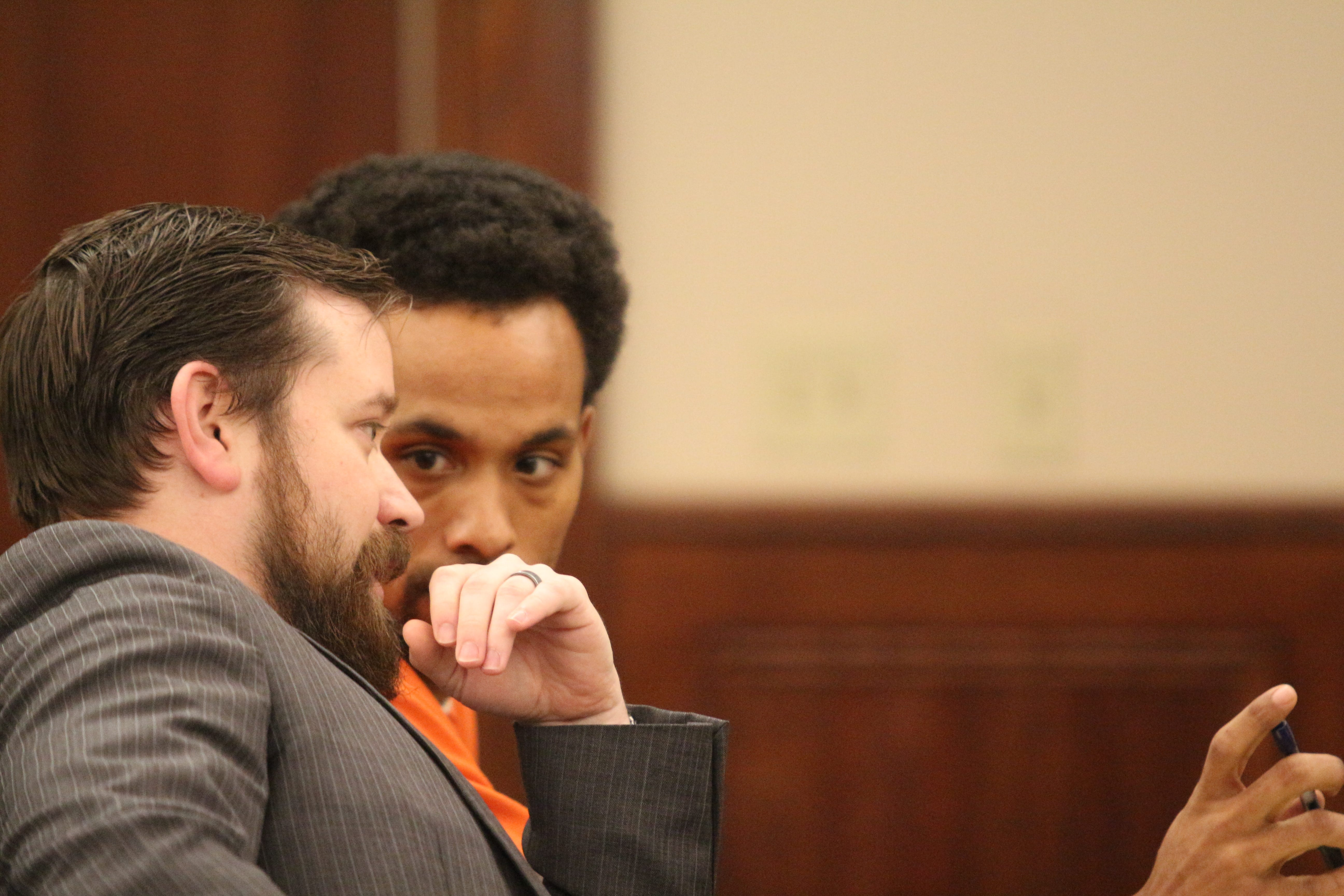 Vincent Bryan Merriweather talks to his attorney, Jacob Fendley at his preliminary hearing on homicide charge