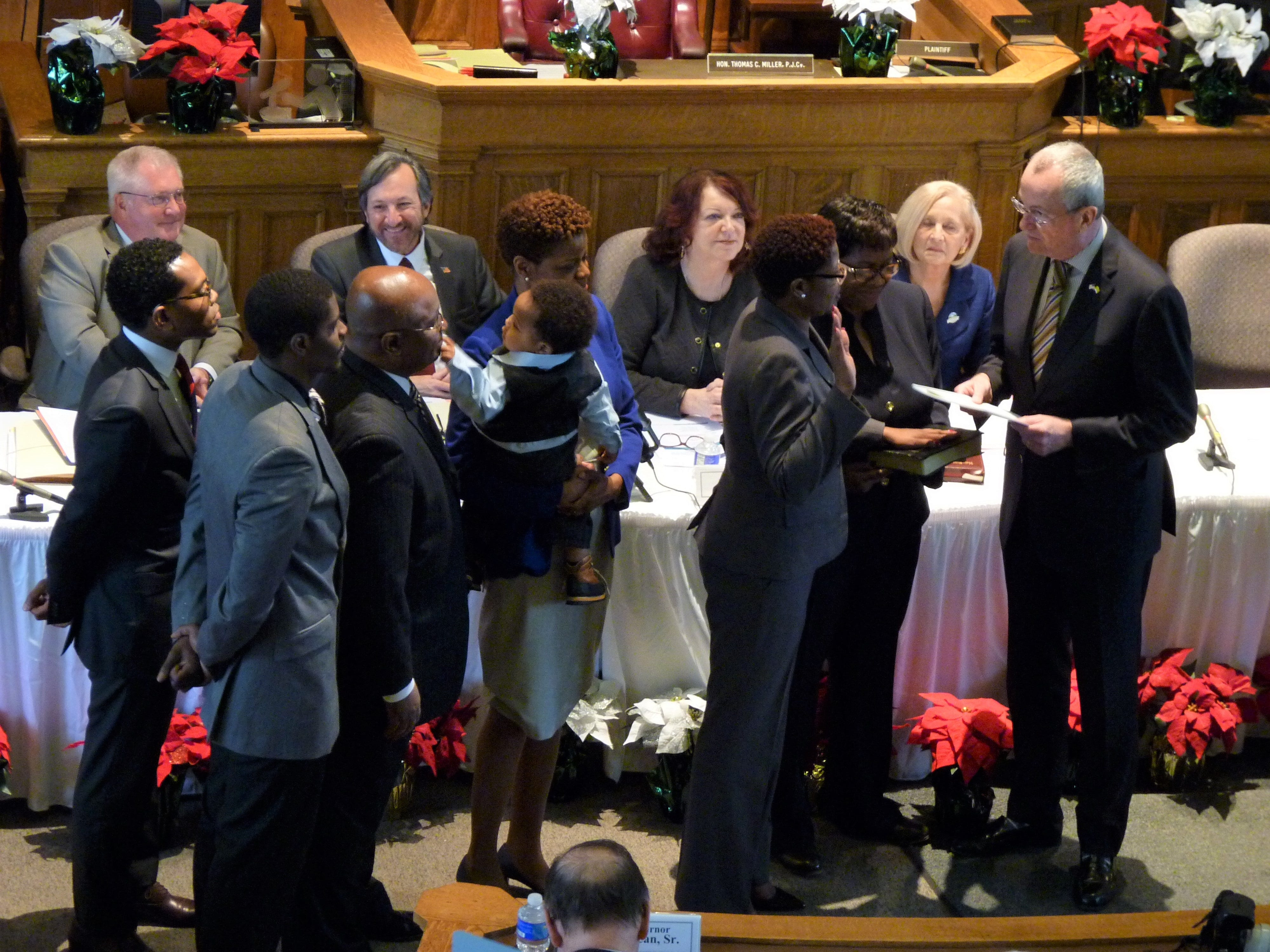 With her family behind her, Shanel Robinson is sworn in as Somerset County freeholder by Gov. Phil Murphy. Robinson and Sara Sooy became the first Democrats to serve on the freeholder board in more than three decades.