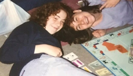 Liza Walter-Larregui and Nancy Noga playing Monopoly