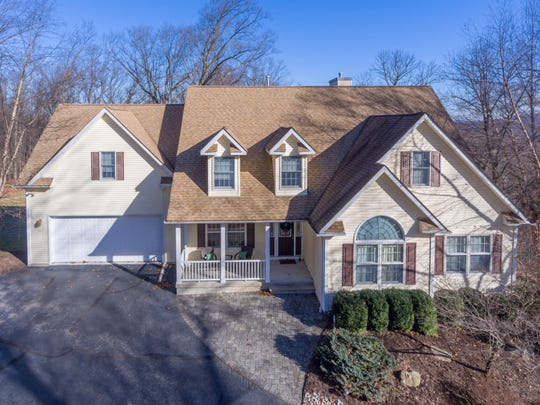 A custom-built Colonial Cape is being offered in Raritan Township.