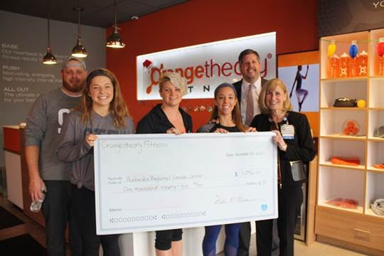 Staff from Orange Therapy Fitness in Flemington presented a check to Philippe Beekman, senior vice president, Hunterdon Healthcare Foundation and Barbara Tofani, administrative director, Hunterdon Regional Cancer Center.