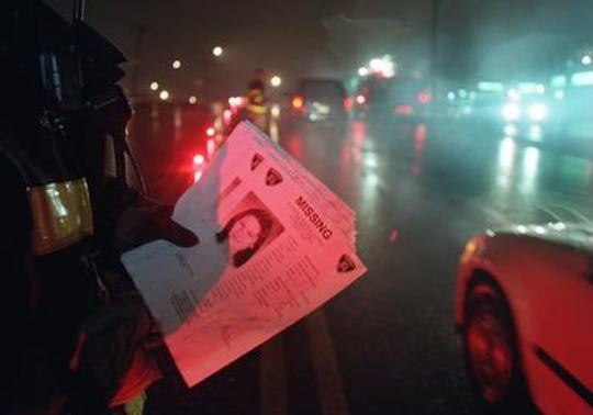 Fliers with a photo of Nancy Noga who was killed in front of the Mini Mall on Ernston Road were handed out by firefighters in hopes of finding leads from drivers who may have seen something on Jan. 7, 1999, the night she disappeared.