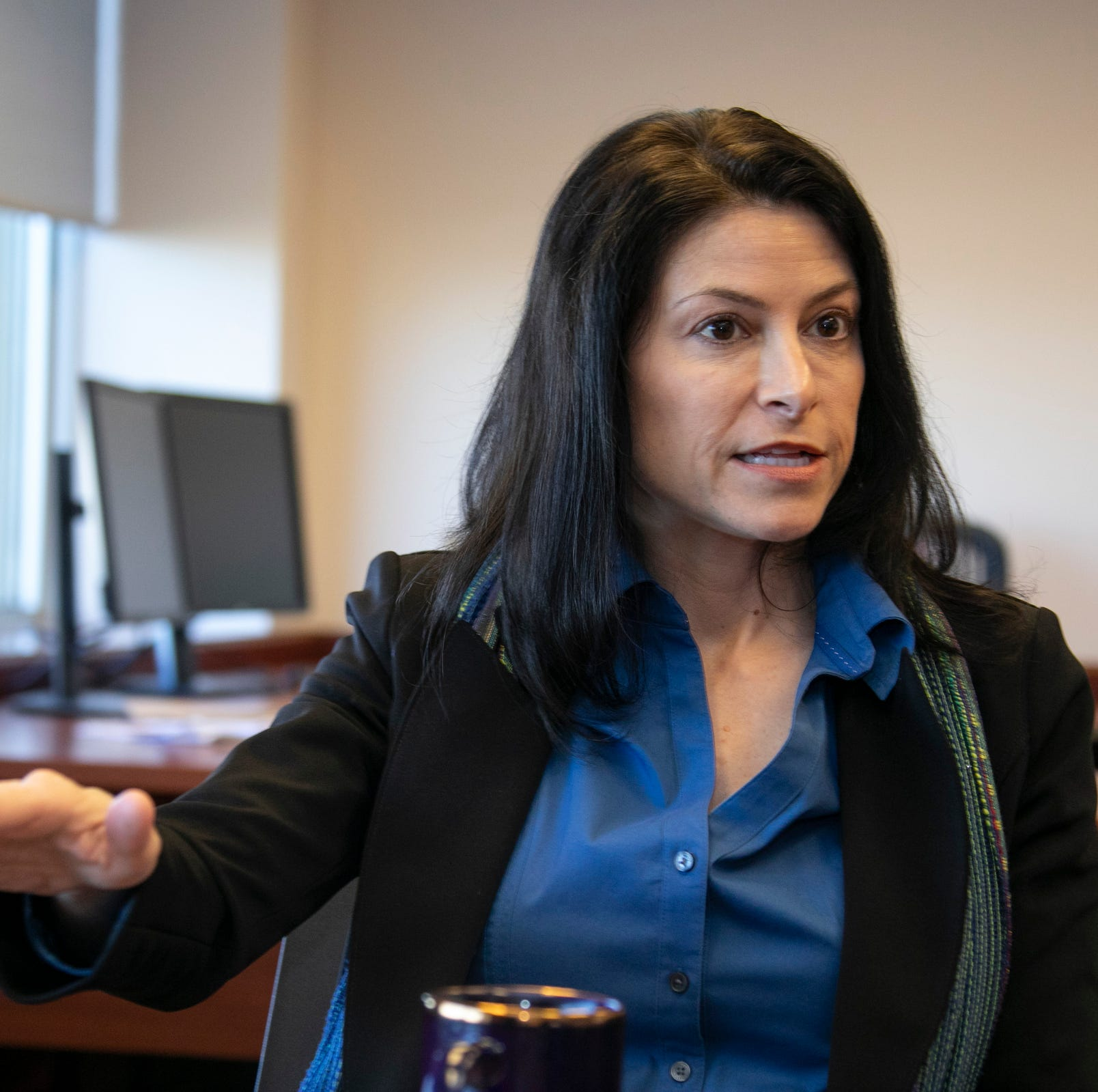 Michigan Attorney General Dana Nessel talks to the press Friday, Jan. 4, 2019 at her office in Lansing.
