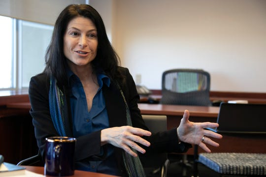 Michigan Attorney General Dana Nessel talks to the press Friday, Jan. 4, 2019 at her new office in Lansing.