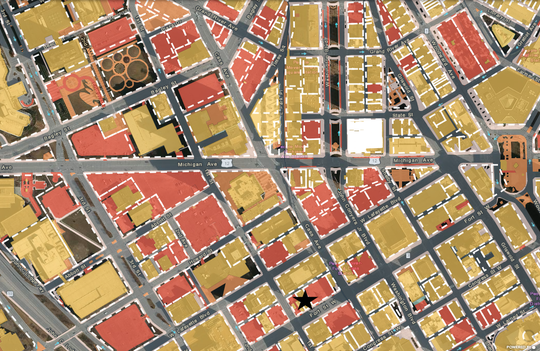 A map of downtown Detroit around the old Detroit Saturday Night building. The starred parcel is 550 W. Fort Street. Red parcels are driveways/parking lots. Yellow parcels are buildings.