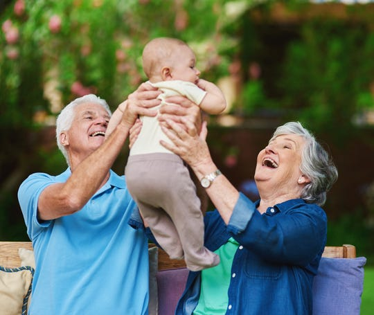 Cropped shot of a senior couple spending time with their grandson
