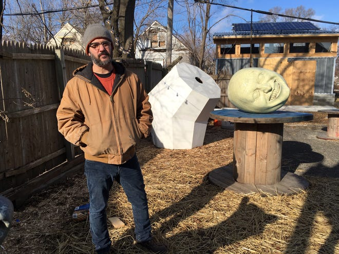 Graem Whyte's white geometric sculpture is among several in the backyard of Popps Emporium.