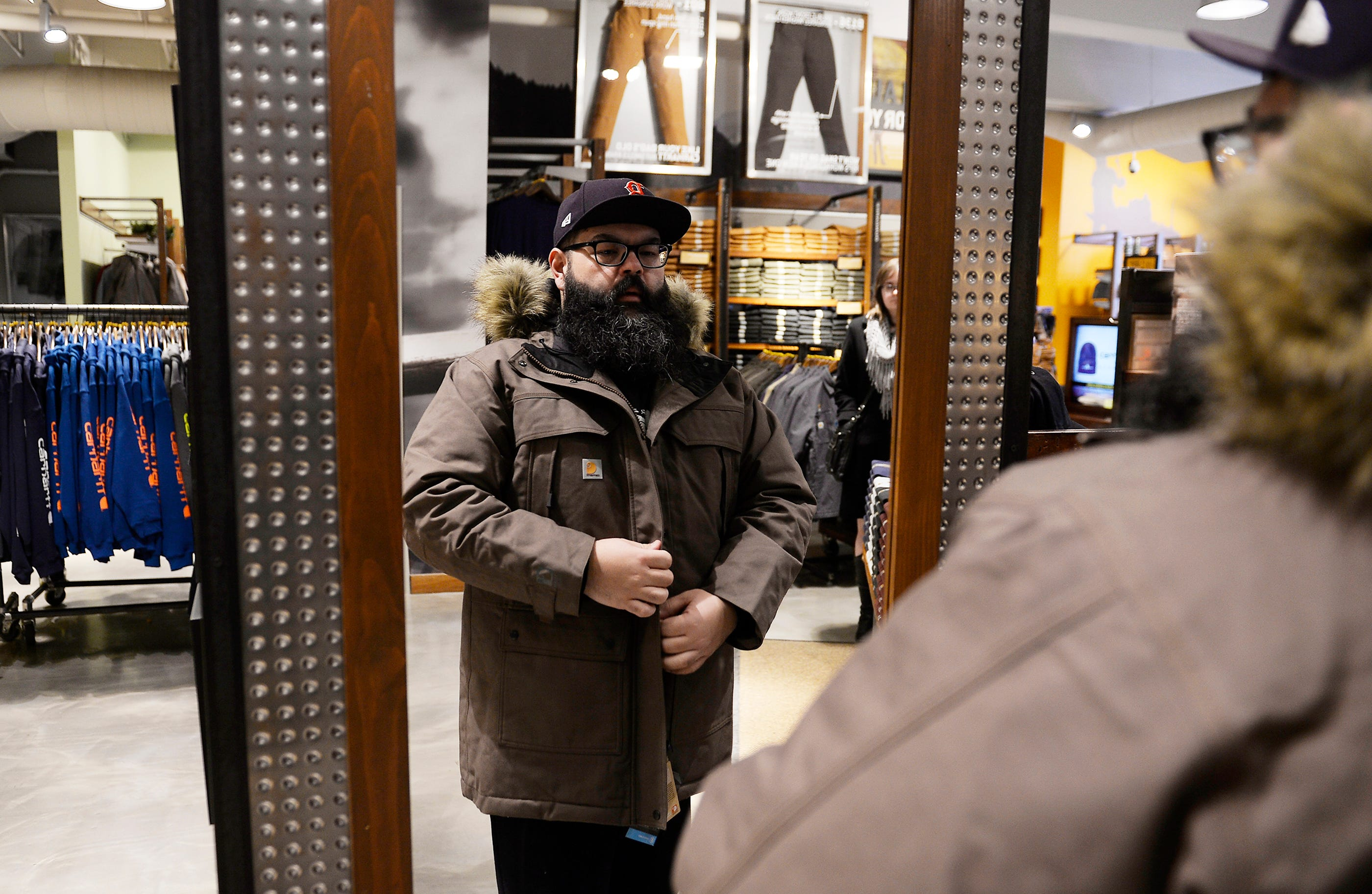 Sal Rodriquez of St. Clair Shores tries on a Sawtooth Parka at the Carhartt store in Detroit.