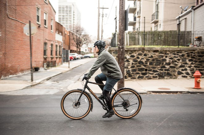 With the right apparel, cycling all winter long can become both feasible and comfortable. (Grace Dickinson/Philadelphia Inquirer/TNS)