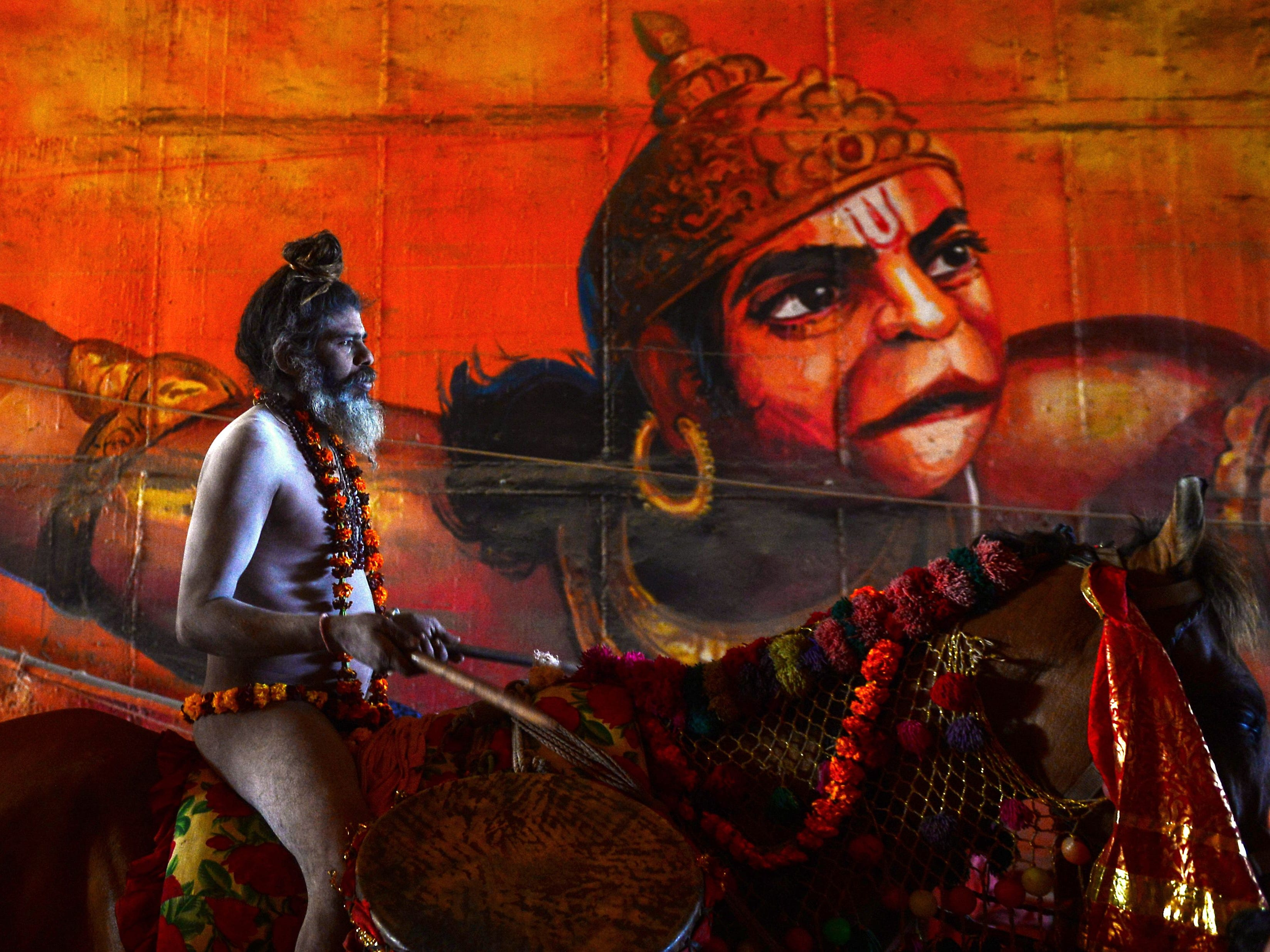 An Indian naked sadhu (Hindu holy man) rides a horse as he takes part in a religious procession towards the Sangam area during the 'royal entry' for the upcoming Kumbh Mela festival in Allahabad on Jan. 4, 2019. The festival attracts millions of Hindu pilgrims to the sacred confluence of the Yamuna and Ganges rivers over 49 days between January 15 and March 4.
