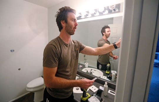 Federal contractor Chris Erickson prepares to paint his bathroom Friday, Jan., 4, 2019, in North Salt Lake, Utah. Erickson says he'll run out of vacation days if the shutdown continues.
