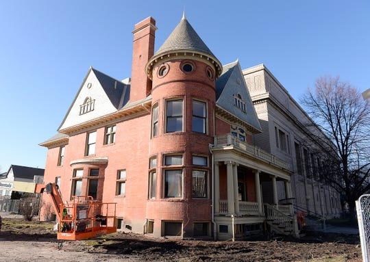 The David Mackenzie house on Cass Avenue, built in 1895, was the home of Wayne jState University's founder.