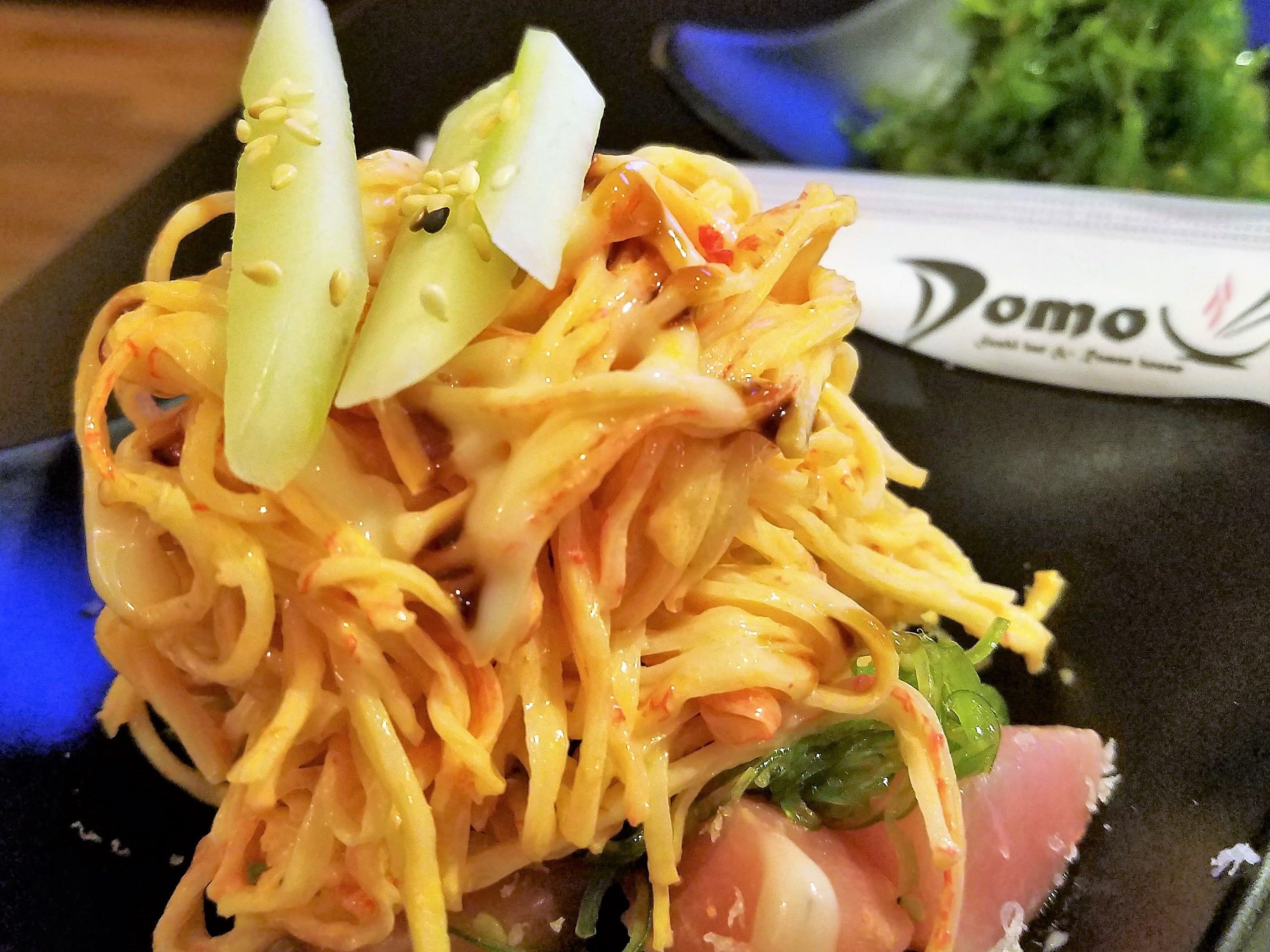 The Domo Salad--diced fresh tuna, spicy crab, and seaweed salad with cucumber and a sweet soy drizzle.