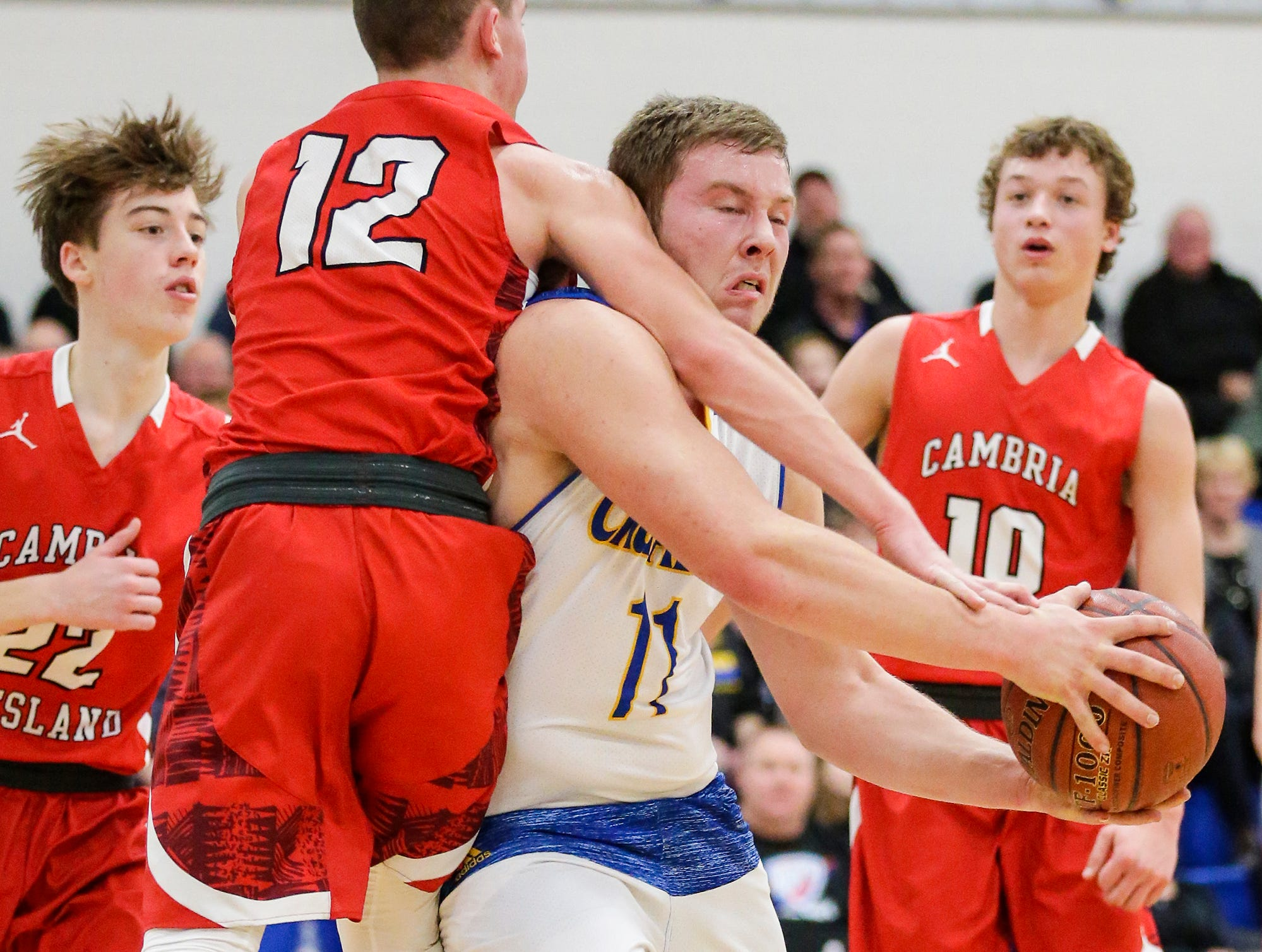 Central Wisconsin Christian High School boys basketball's Grant Kooiker gets fouled by Cambria-Friesland's Colt Wentland during their game Thursday, January 3, 2019 in Waupun. Cambria-Friesland won the game 62-61. Doug Raflik/USA TODAY NETWORK-Wisconsin