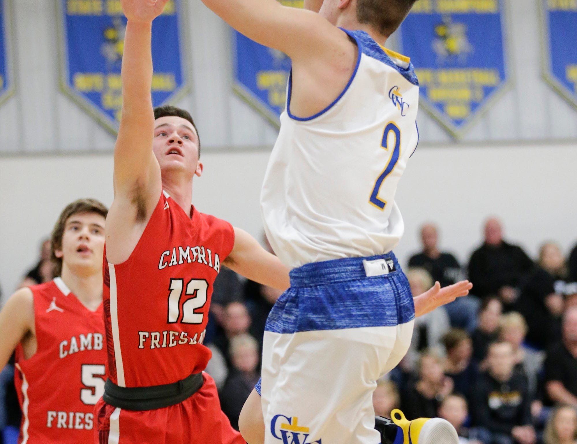 Central Wisconsin Christian High School boys basketball's Zach Vander Werff goes up for a shot against Cambria-Friesland's Colt Wentland during their game Thursday, January 3, 2019 in Waupun. Cambria-Friesland won the game 62-61. Doug Raflik/USA TODAY NETWORK-Wisconsin