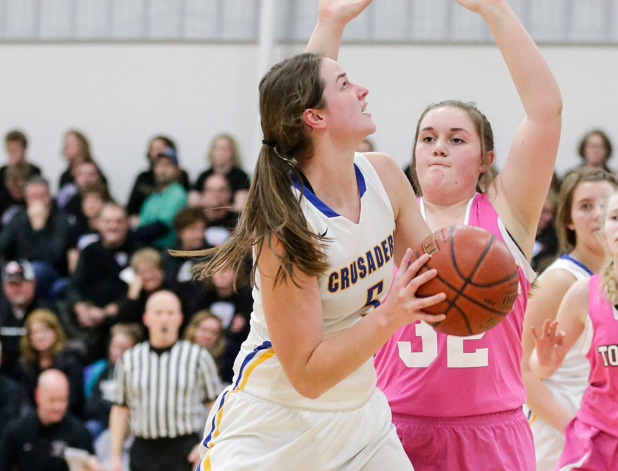 Central Wisconsin Christian High School girls basketball's Melissa Van Den Berg eyes up the basket against Cambria-Friesland's Abbigail Schwark during their game Thursday, January 3, 2019 in Waupun. Cambria-Friesland won the game 58-44. Doug Raflik/USA TODAY NETWORK-Wisconsin