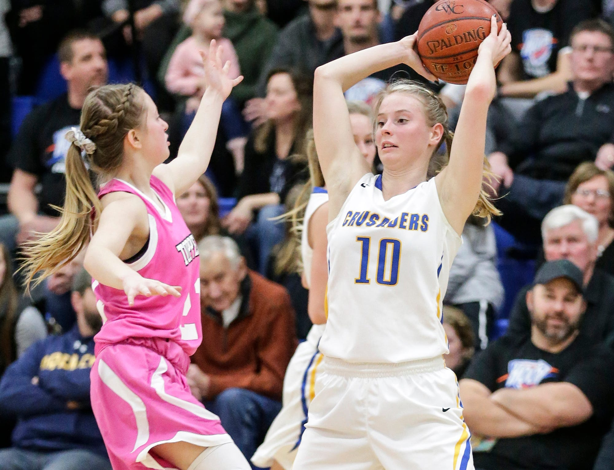 Central Wisconsin Christian High School girls basketball's Claire Jansen looks to pass the ball against Cambria-Friesland's Haley Olson-Deisnger during their game Thursday, January 3, 2019 in Waupun. Cambria-Friesland won the game 58-44. Doug Raflik/USA TODAY NETWORK-Wisconsin