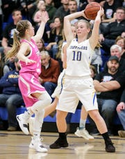 After four years on varsity, Central Wisconsin Christian senior Claire Jansen earned her 1,000th point Friday against Princeton/Green Lake.