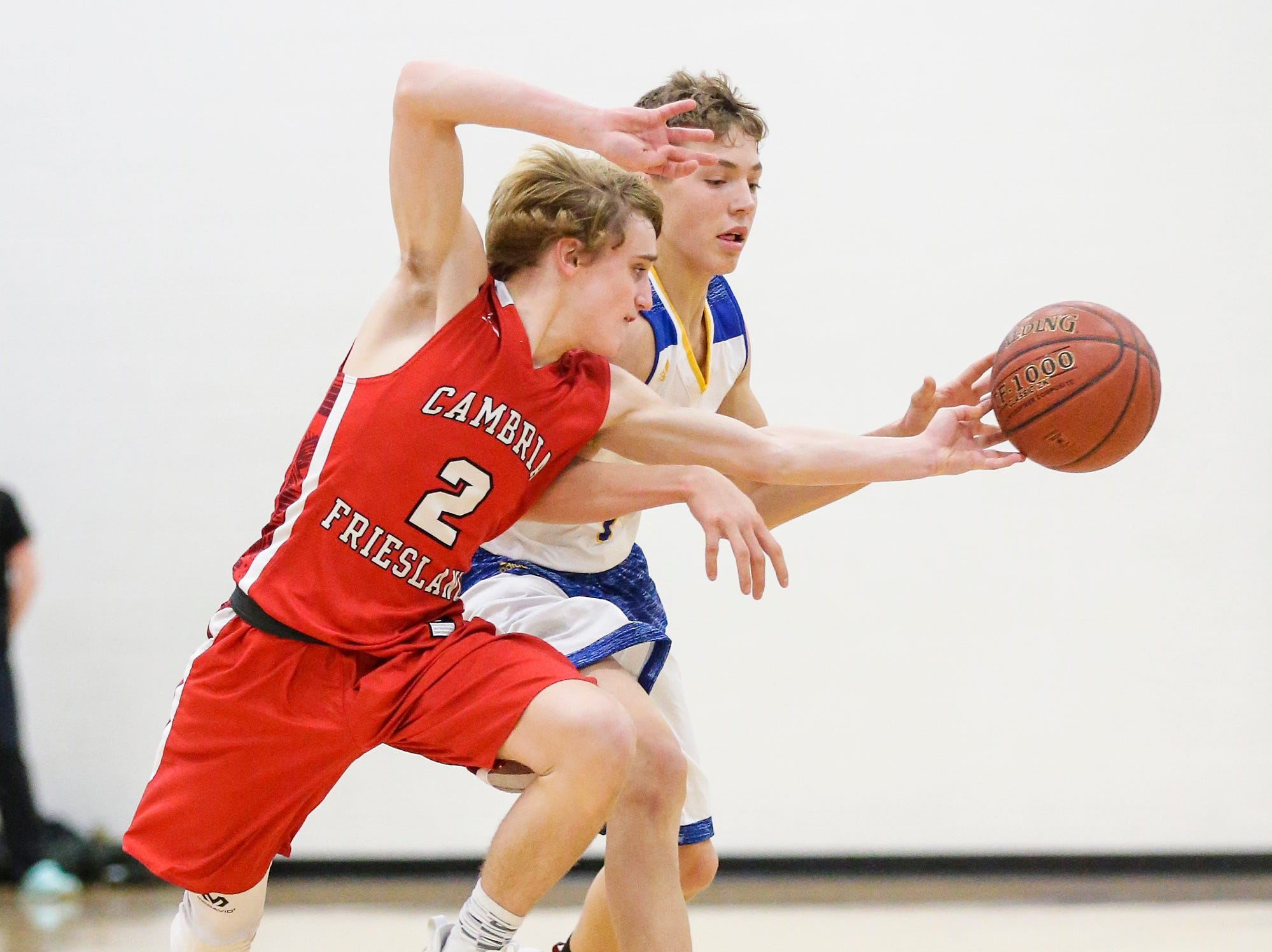 Central Wisconsin Christian High School boys basketball's Riley Westra gets the ball knocked away from him by Cambria-Friesland's Cade Burmania during their game Thursday, January 3, 2019 in Waupun. Cambria-Friesland won the game 62-61. Doug Raflik/USA TODAY NETWORK-Wisconsin