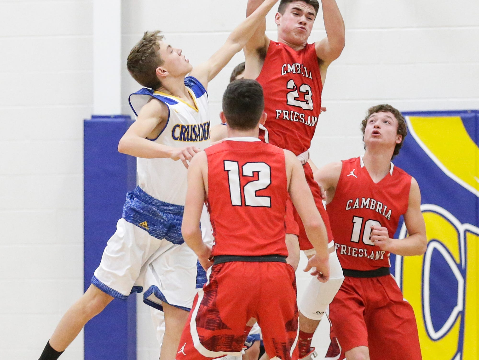 Central Wisconsin Christian High School boys basketball's Riley Westra and Cambria-Friesland's Griffin Hart go up for a rebound during their game Thursday, January 3, 2019 in Waupun. Cambria-Friesland won the game 62-61. Doug Raflik/USA TODAY NETWORK-Wisconsin