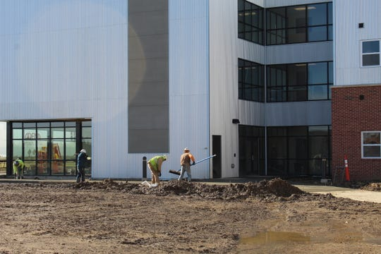 Work continued Friday on the Landings at Terra Village. The Terra State Community College housing facility opened to students in August, as University Housing Solutions has continued working to finish the project.