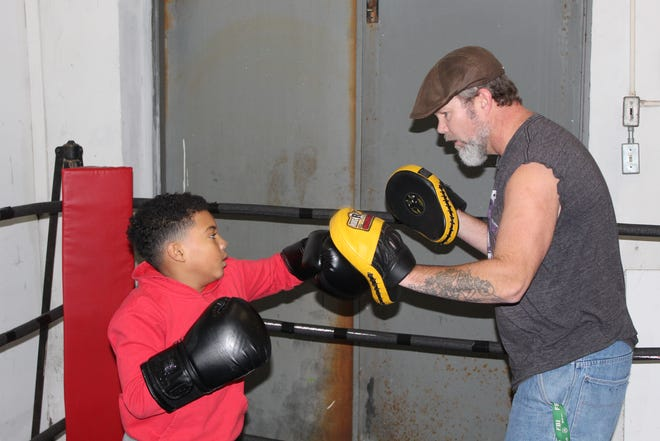 Nathan Sims, 10, works on left and right punching combinations during practice Thursday at Fremont Wreckers.