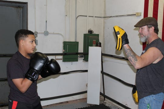 Elijah Karlovetz, 13, works on timing with coach Joe Laughlin at the Fremont Wreckers Boxing Club on Thursday, preparing for a fight Saturday in the Silver Gloves tournament in Columbus.