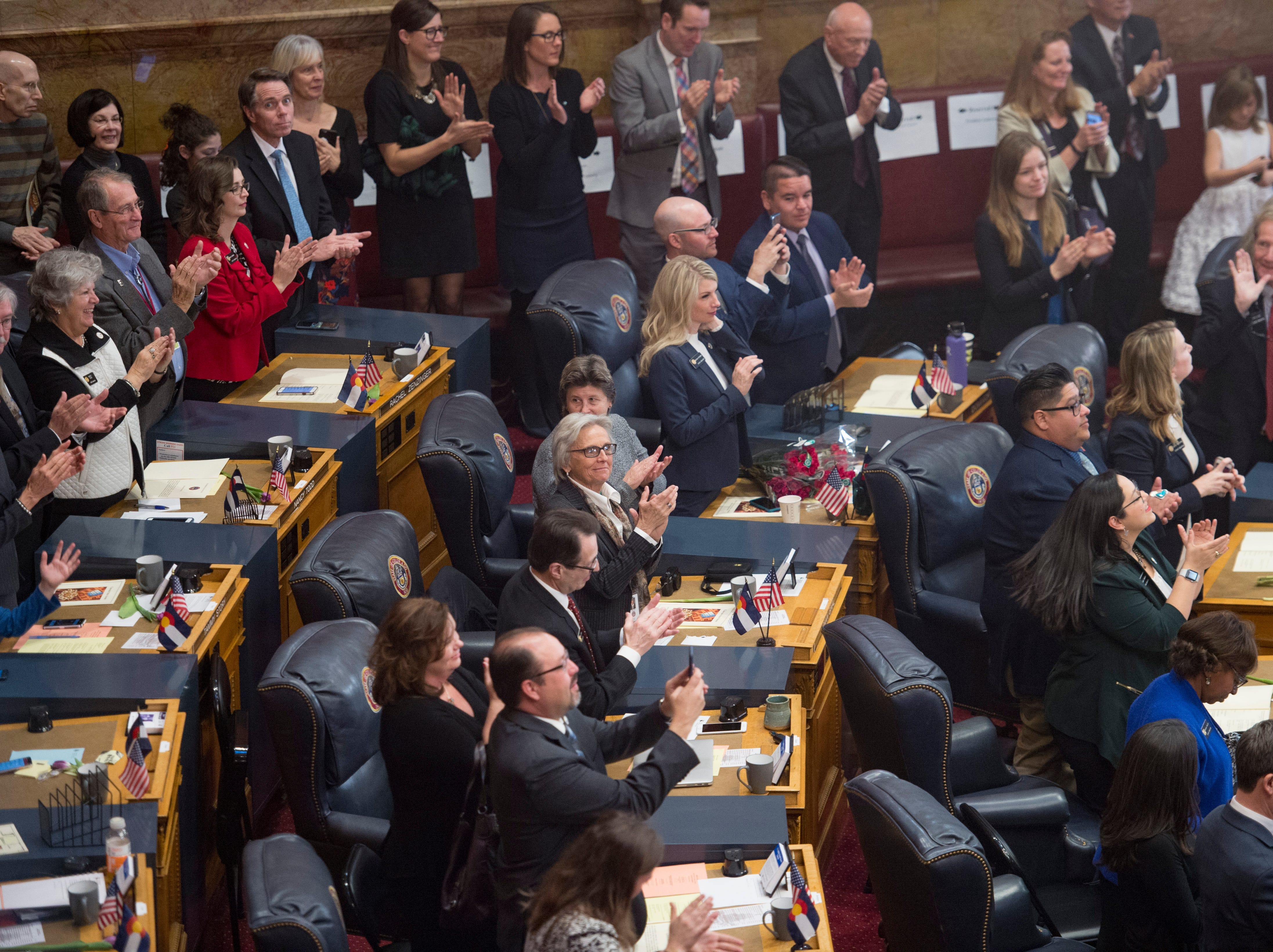 State Senators stand to applaud as the 72nd General Assembly convenes at the Colorado State Capitol on Friday, January 4, 2019.
